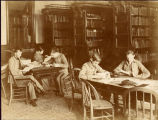 1890s: Students studying in the library