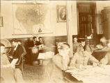 1890: Dr. Charles Coleman Thach and students in library