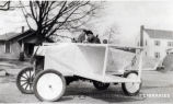1928: Student in automobile fixed to look like airplane