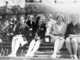 1929: Co-eds sitting in stands at football game