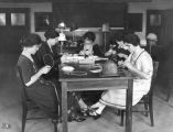 API student activities: millinery class, 1925
