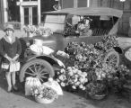 Mrs. J. E. Spiller and her daughter selling flowers from her car at the Tucaloosa curb market