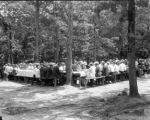 Alabama newspaper editors enjoying a barbecue given by citizens at Lake Condy in Opelika, Lee...