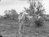 Clyde Wood in peach orchard with Burr clover in Sulligent, Lamar County, Alabama
