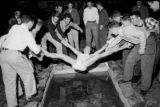 1951: API Pi Kappa Alpha member Jack Johnson about to be dunked in the fish pond