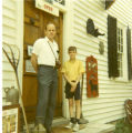 Eugene B. Sledge and son John outside Stoner's Store