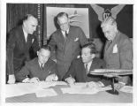 Douglas Aircraft Company signing a contract with three airlines