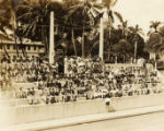 Military swim meet: spectators in stands, Hawaii, 1930s