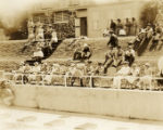 Military swim meet: officers and their wives viewing the meet, Hawaii, 1930s