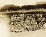 Military swim meet: spectators and military band in stands, Hawaii, 1930s