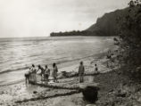 People on a beach in Hawaii in the 1930s