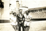 Everett Leavins and two women on a pier in Hawaii in the 1930s