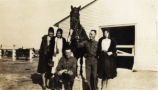 Everett Leavins, another soldier, three women and a horse, Fort Oglethorpe, Georgia, circa...