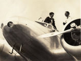 Amelia Earhart and Paul Mantz on Earhart's plane, Hawaii, 1937