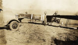 Biplane resting upside down on the ground in Hawaii