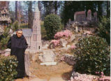 Brother Joseph by Miniature of St. Martins Cathedral, Ave Maria Grotto, Cullman, Alabama