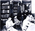 1890s: Cadets studying in library