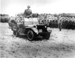 "1945: Gen. Patton rides a ""War Eagle"" Jeep"