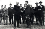 1928: A-Day handshake between API Presidents Dowell and Knapp