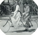 1937: Students in Gay Nineties costumes on historic tandem bike